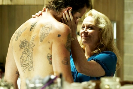 Jacki Weaver (right) comforts Sullivan Stapleton (left) after a family friend is gunned down early on in the film.