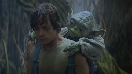 Yoda putting Luke Skywalker through training star wars empire strikes back